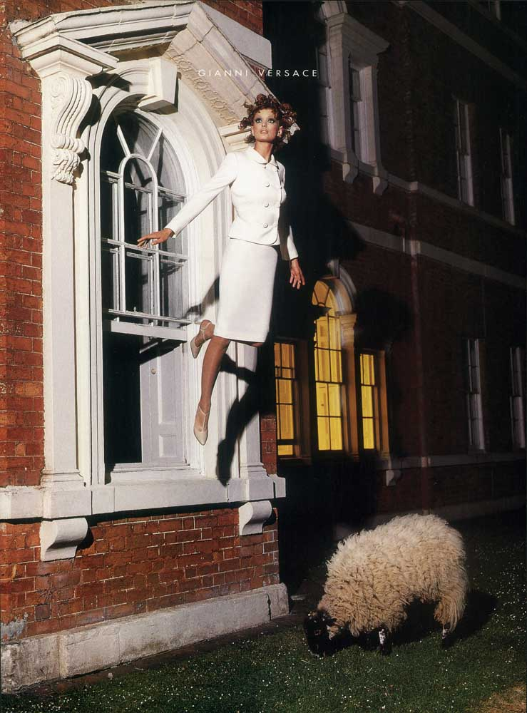 Fashion shoot, model in Gianni Versace accompanied by Blackberry the sheep