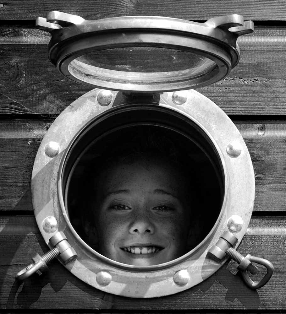 Jed looking out through the porthole