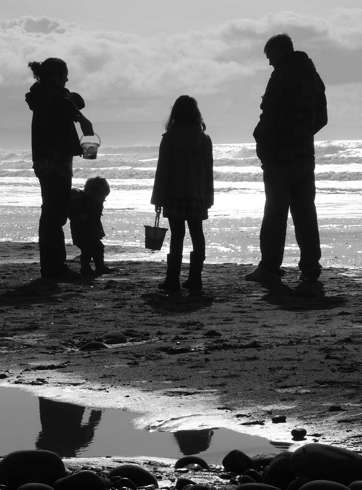 End of the day, family silhouette on beach
